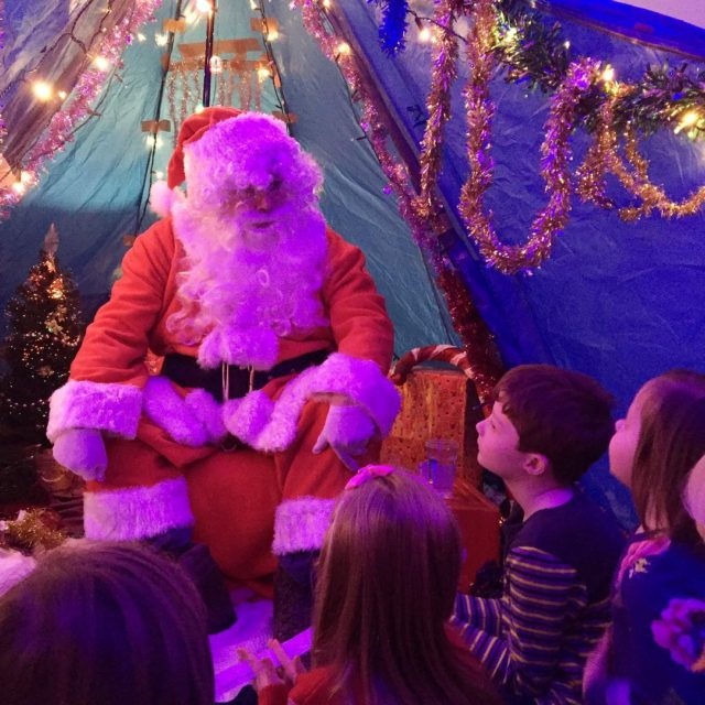 Visiting Father Christmas at the school fair he was sohellip