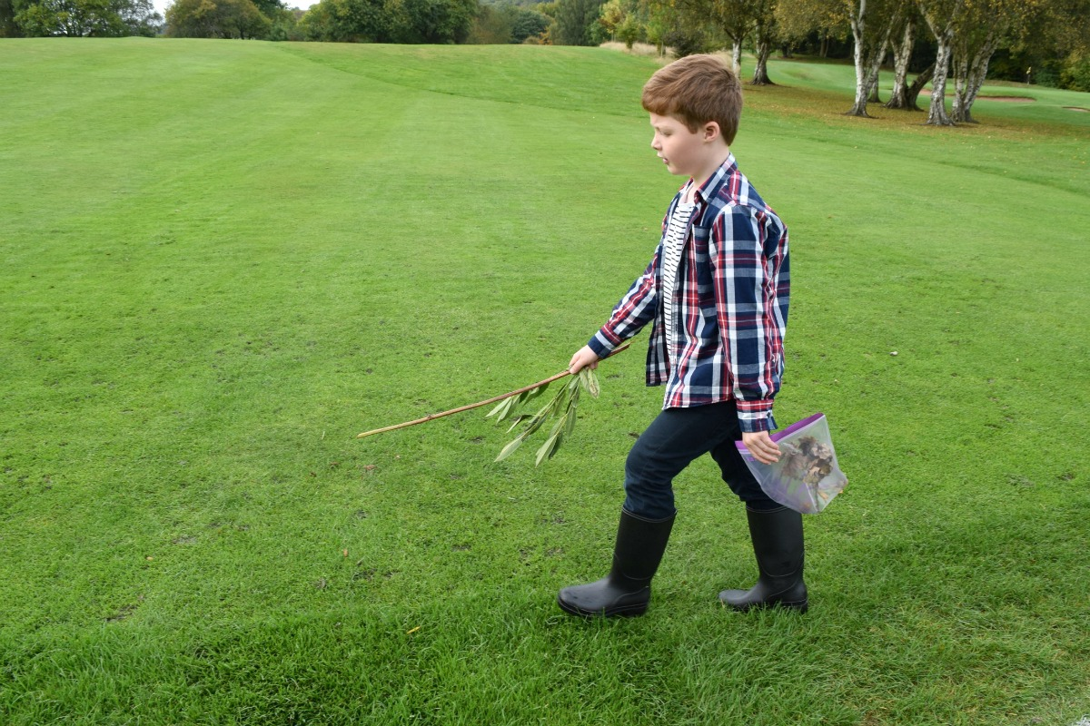 Sam walking over the golf course