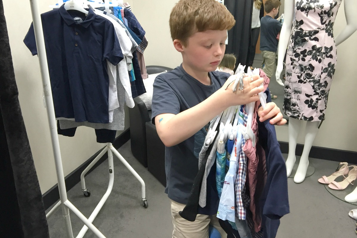 Sam choosing his clothes from Debenhams