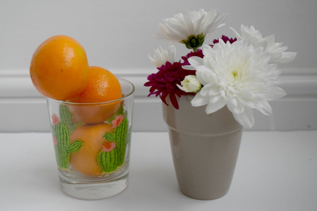 Tangerines, flowers and a cactus glass http://rainbeaubelle.com