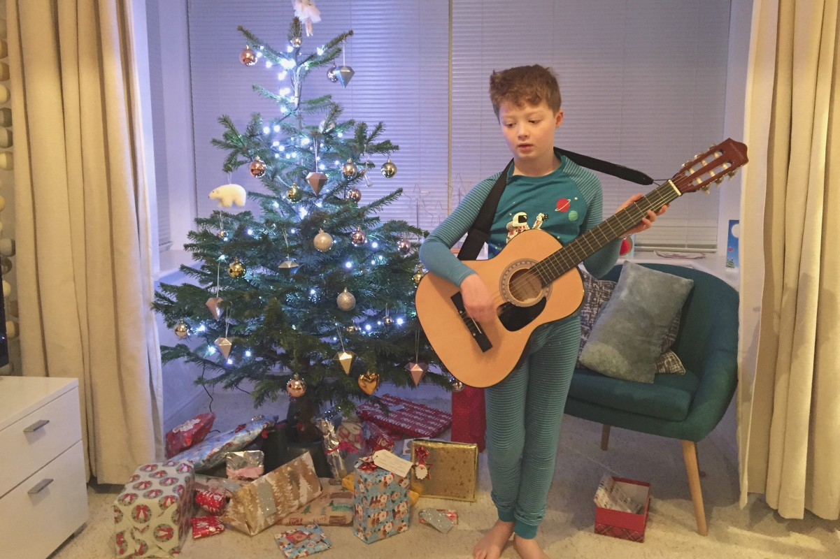 Sam playing guitar on Christmas Day