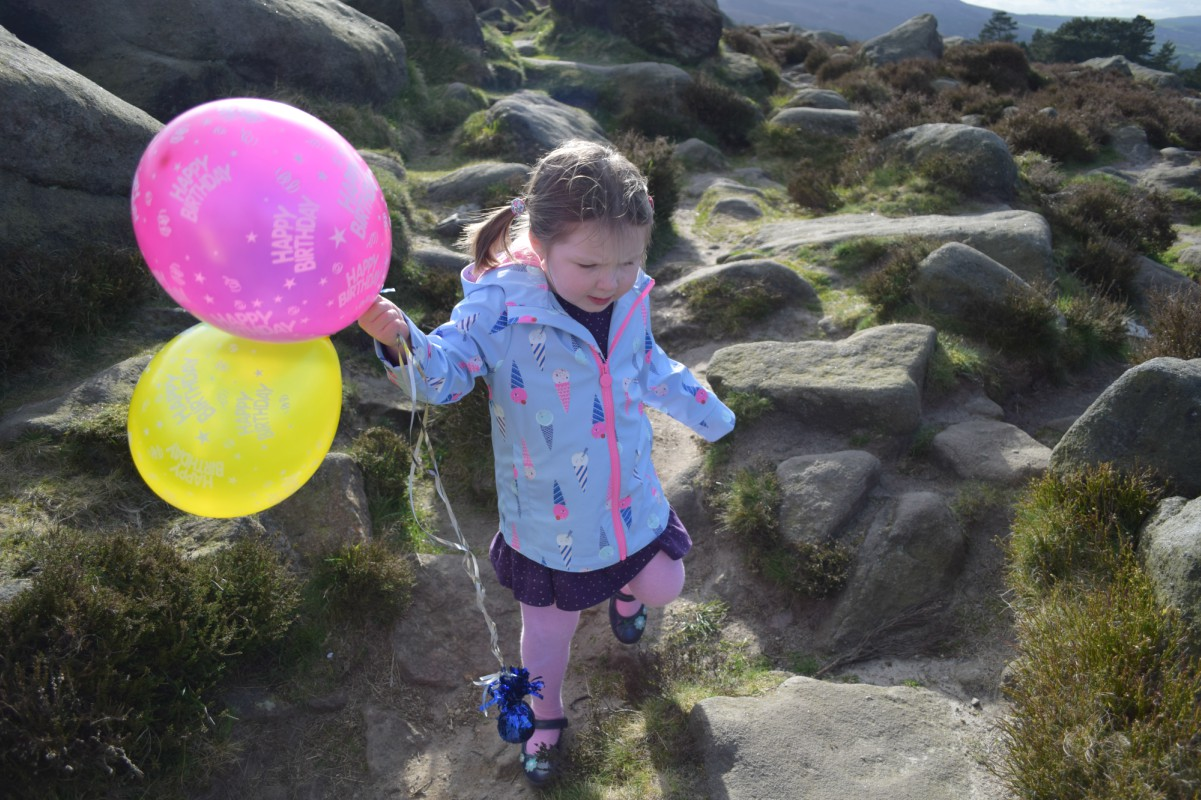 Flo with balloons on the moor