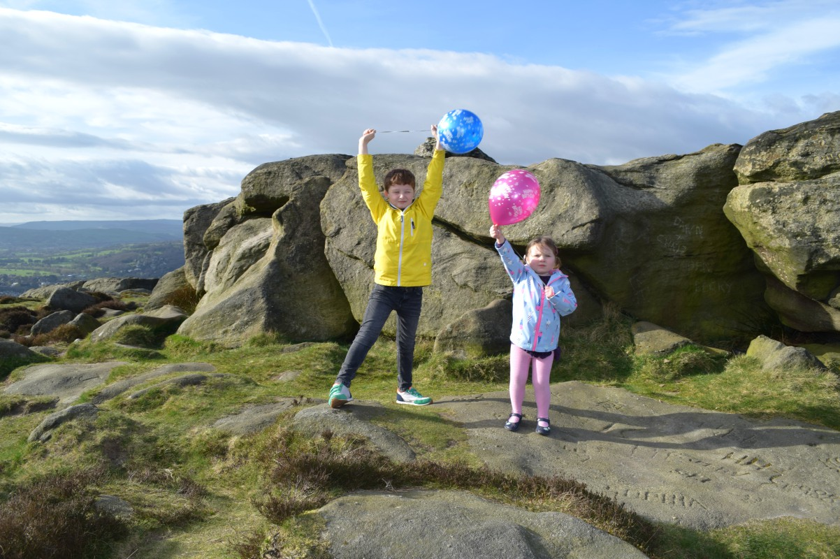 Sam and Flo on the moor with balloons
