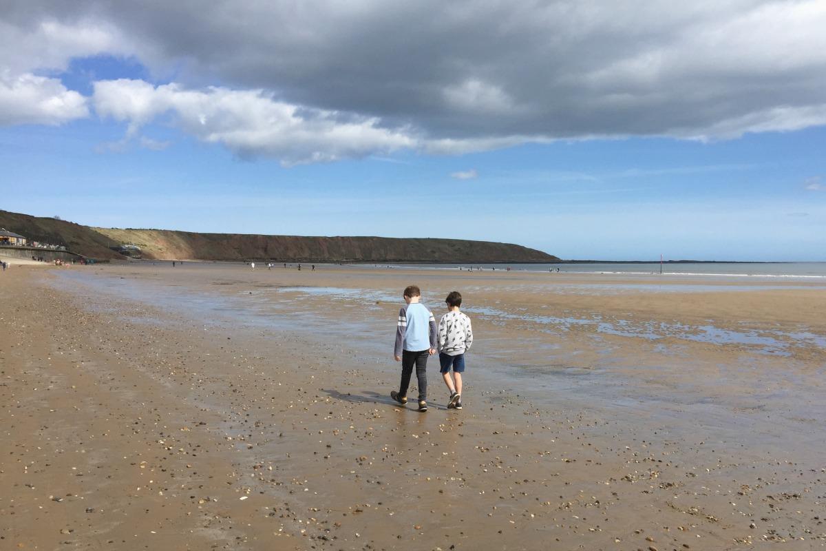 Sam and Joe on the sand at Filey