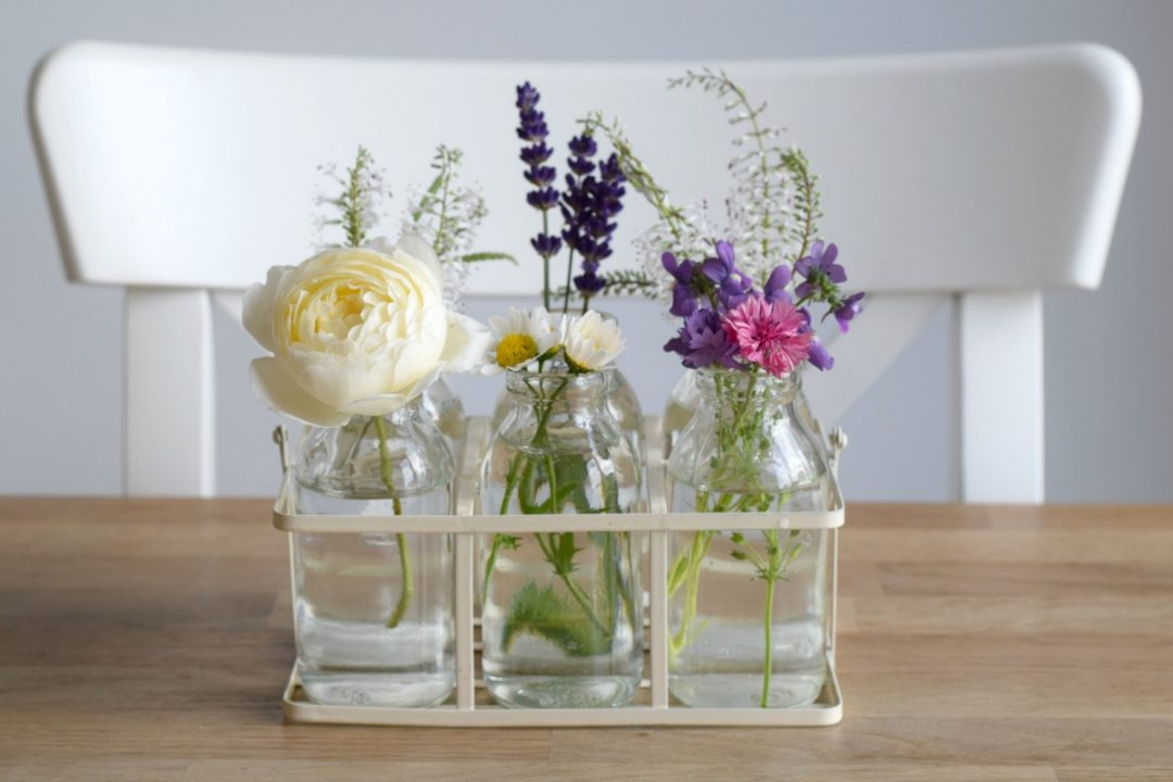 Flowers in milk bottles Rainbeaubelle.com