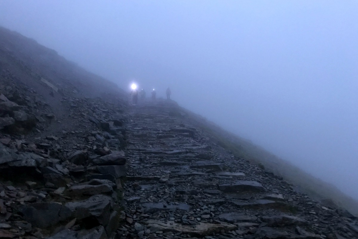 Walking down Snowdon in dark head torches
